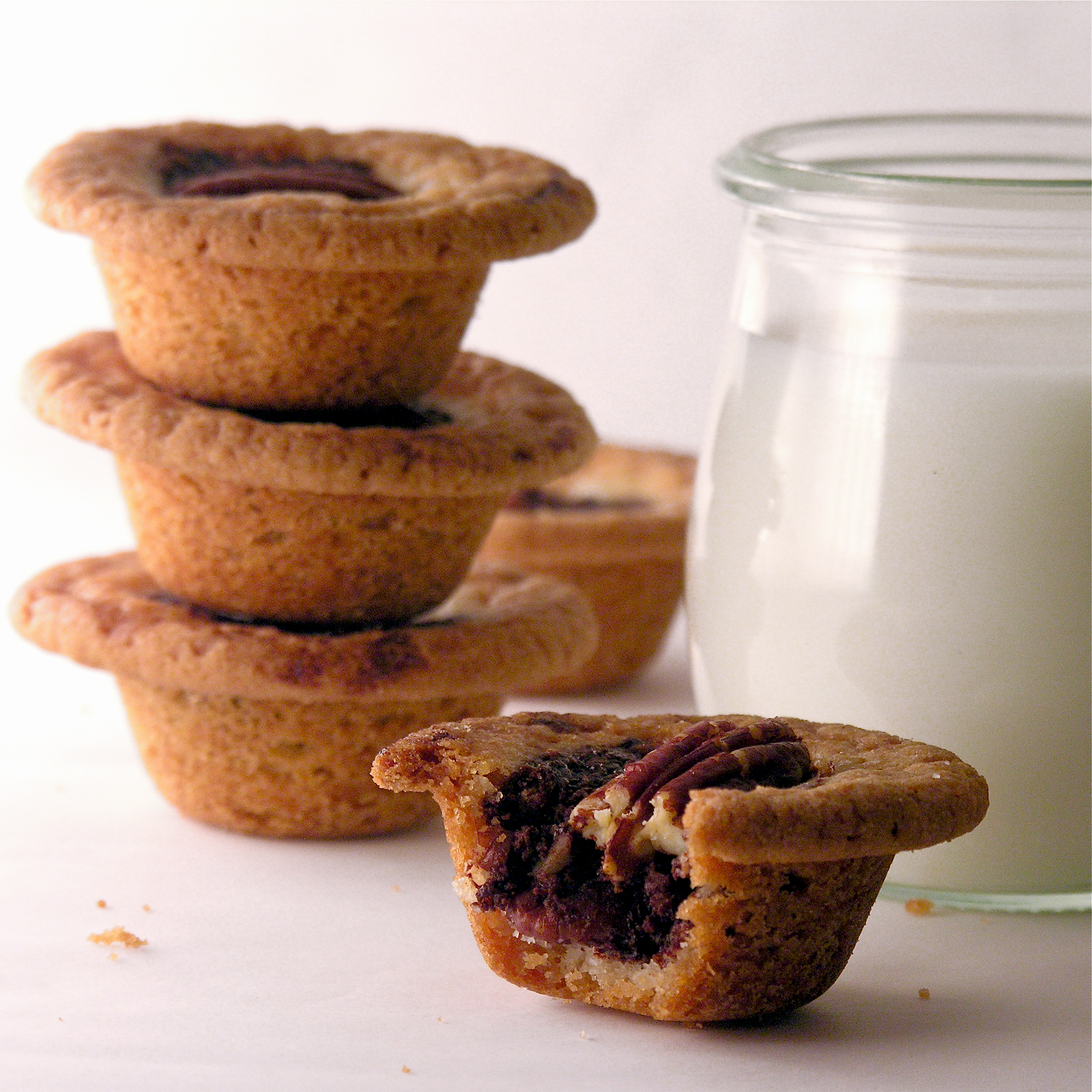 Dark chocolate and pecans baked in a soft sugar cookie cup–yum!