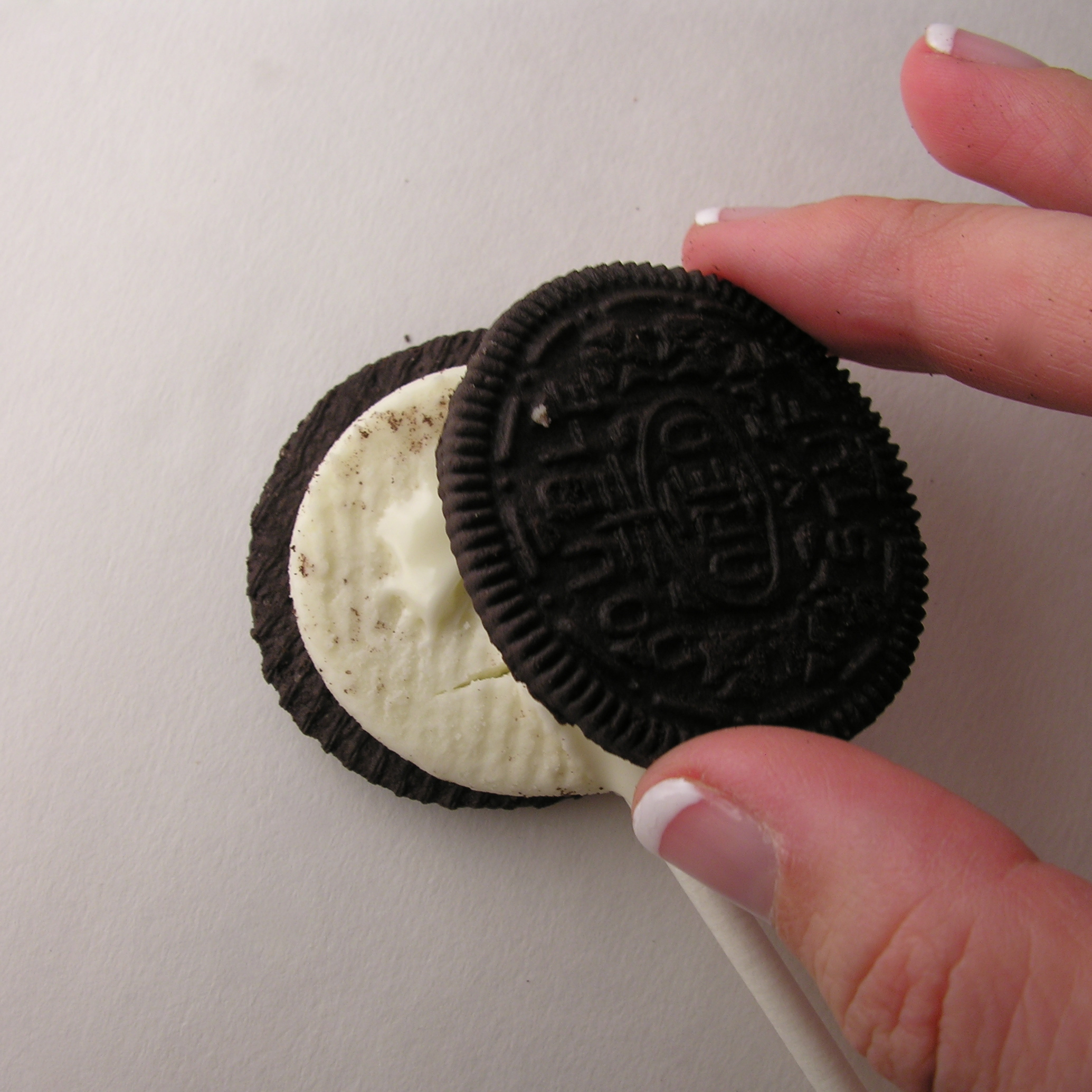 Oreo (/ ˈ ɔːr i oʊ /) is a brand of cookie usually consisting of two chocolate cookies with a sweet crème filling, marketed as