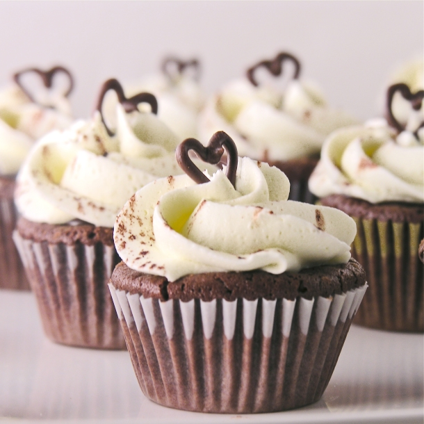 Dark chocolate cupcakes topped with ganache and vanilla buttercream ...