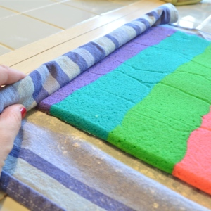 Roll cake in towel, starting at short end.