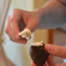 Spread buttercream over sides of mini cupcake