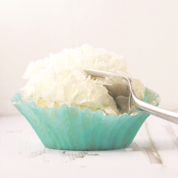 These coconut cupcakes are infused with coconut cream and topped with ...